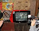 Ayue Shibo, a village farmer from Yuexi County, Sichuan Province show us his new TV donated by WWF. It's powered by a micro hydro-power system that has been set up in the village.