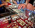 A customer regards the products on sale at a shop selling elephant ivory amulets in Bangkok, Thailand.