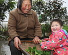 People living happily in the Upper Yangtze region, where constructed wetlands are helping families recycle household wastewater.